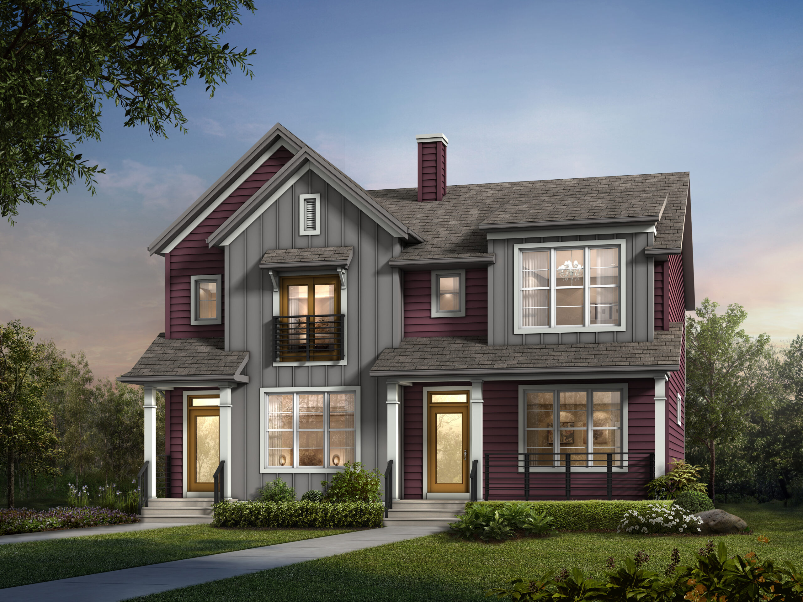 A modern farmhouse duplex home with detached garage features white window trim and multicolored siding, including a wide front porch.