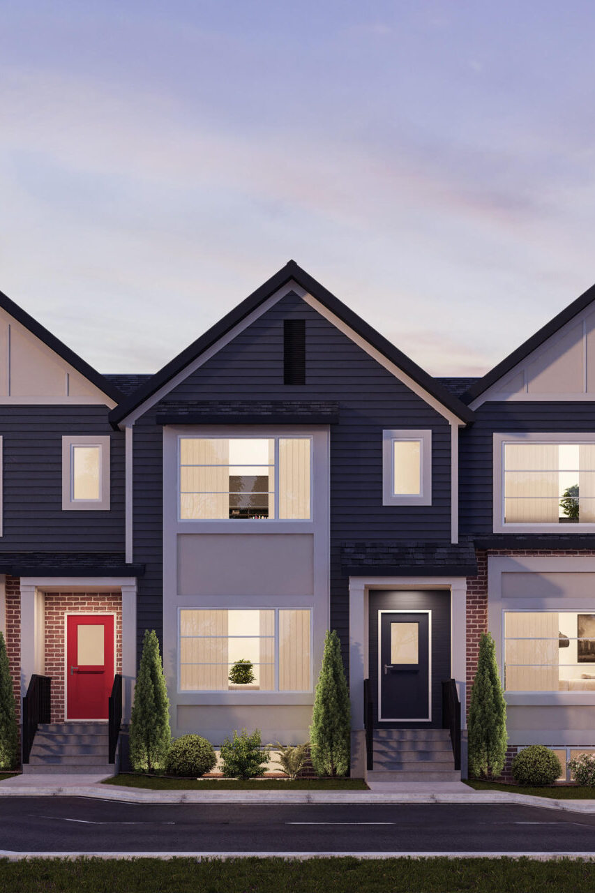 A modern brownstone townhome complex features white window trim and multiple building materials, including siding and brick, to create an interesting streetscape.